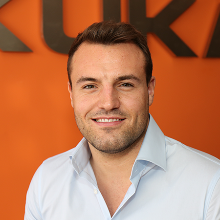 Portrait of Jonathan Pick in front of KUKA logo background